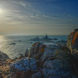 LOW SUN OVER CORBIERE POINT by Robin Simmons
